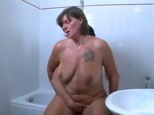 Grey haired ordinary housewife with super saggy tits rides dick in bathroom