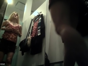 Stacked blonde exposes her hot curves in the changing room
