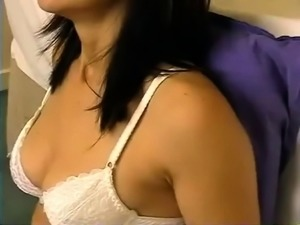 Masked brunette with lovely tits feeds her lust for hot piss