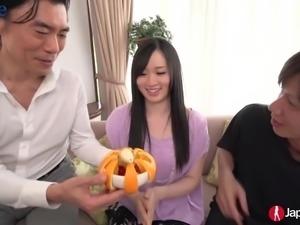 Svelte Japanese girl Yuka Wakatsuki works on two hairy cocks pleasantly