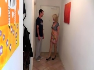 Stacked blonde milf seduces a nerdy boy to drill her pussy