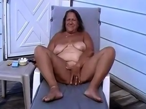 Curvy mature lady pleases her snatch with sex toys outside
