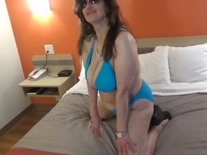 Tinja Stretches A Blue String Bikini
