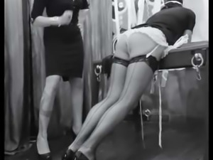 Spanked sissy maid