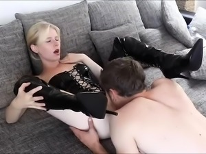 Enticing blonde in latex takes a deep fucking on the couch