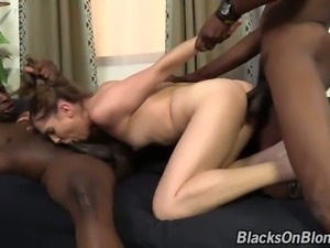 Pigtailed cheerleader bitch Kasey Warner swallows 2 giant black cocks