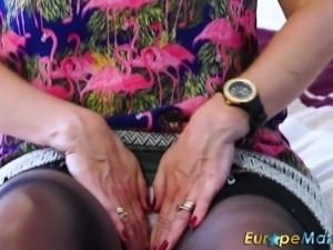 Kinky mature whore Lilly May gets rid of dress to masturbate her wet pussy