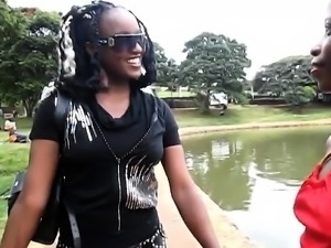 Ebony Lesbians enjoy taking a stroll near the lake. After