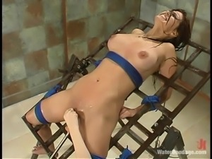 Petite sex slave is standing all the pain in this BDSM