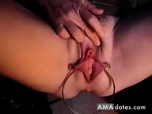 MATURE REDHEAD WITH A BIG RING IN HER LABIA