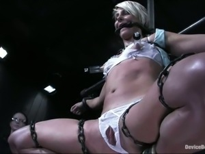 Slender blondie gets suspended in some bondage belts