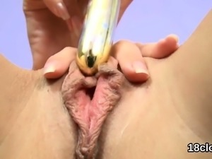 Fervent chick is gaping juicy pussy in close up and having o