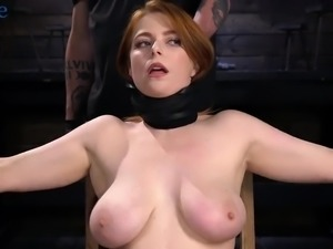 Beautiful redhead Penny Pax gets undressed and tied up for hard masturbation