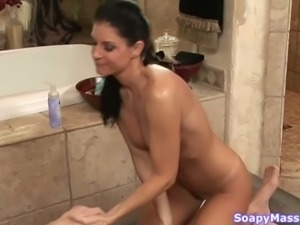 Sensual brunette with sexy tan lines gives blowjob and gets laid in the shower