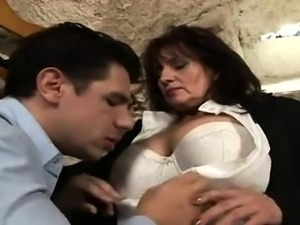 Busty mature brunette needs a young cock drilling her pussy