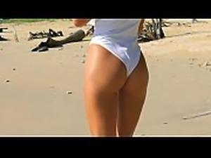 Sexy teen on a beach teasing with her ass in one peace bikini