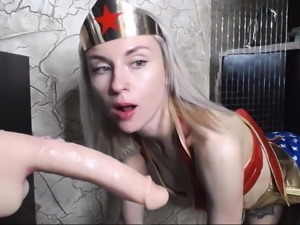 Wonder Woman gives a very deep throat dildo-blowjob !