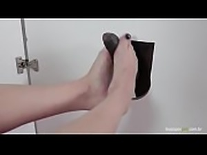 Brazilian blonde gives footjob in the gloryhole! Lilith Scarlett foot fetish!