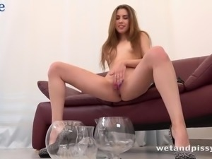 Flat chested young chick Ella Rosa pisses and masturbates herself