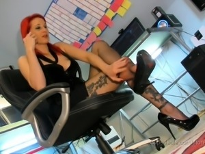 Tattooed redhead in pantyhose caresses her wonderful feet