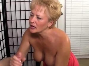 Lusty Mature Blonde Giving a Handjob