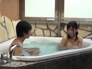 Pretty Oriental teen delivers a great blowjob in the hot tub