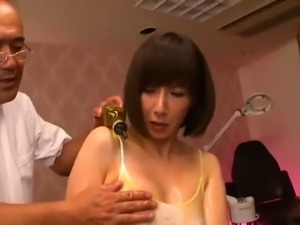 Slender Japanese milf has a masseur fingering her wet pussy