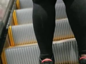 Candid big ebony booty walking in black spandex