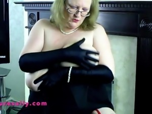 Sally in a black halterneck and long black gloves