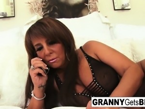 Busty brunette mature takes the black cock in her bed