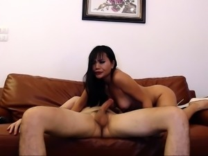 Cute Asian girl with small tits jumps on top of a meat prick