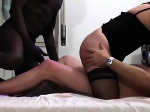 Amateur wife in stockings enjoys an interracial threesome