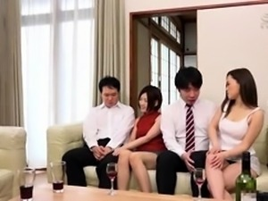 Two lustful Japanese couples engage in wild group sex action