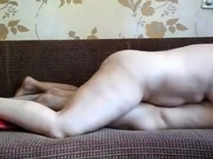 Curvy Russian milf works her hairy pussy on a stiff cock