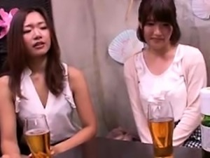Two beautiful Japanese babes indulge in hardcore group sex