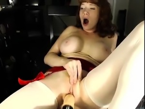 A hot redhead solo with big tis and a big cock