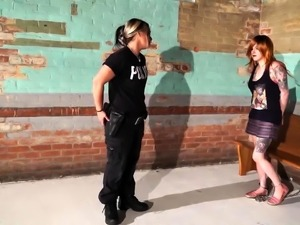 Cute redhead teen gets dominated by a lesbian police officer